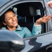 happy-customer-having-car-detailed